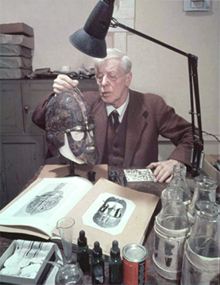 Herbert James Maryon with first reconstruction of the Sutton Hoo helmet.png