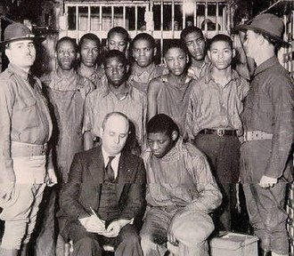 Scottsboro Boys - The Scottsboro Boys, with attorney Samuel Leibowitz, under guard by the state militia, 1932