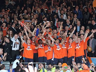 2013–14 Luton Town F.C. season - Luton Town players and staff celebrate winning the Conference Premier in the aftermath of a 4–1 victory over Forest Green Rovers