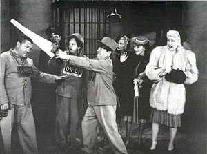 Dorothy Appleby - Dorothy Appleby (second from right) watches in horror as Curly Howard gets a haircut in the film In the Sweet Pie and Pie.