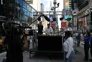 Roy Harter giving a televised almglocken performance in Times Square, New York