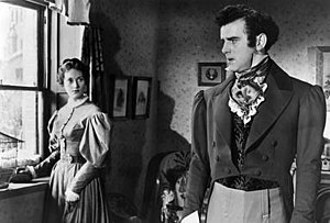 George Cole (actor) - Cole with Rona Anderson in the 1951 film Scrooge