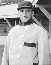 Bobby Wallace in a cap and high-collar coat (black-and-white)