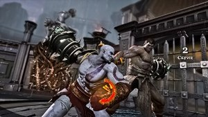 God of War III - Kratos (left) battles boss character Hercules (right). This is an example of a QTE sequence found in all God of War games; moving the right analog stick as shown by the orange arrow will allow him to continue his attack.