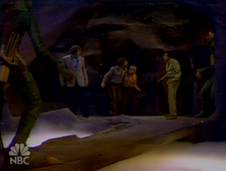 Album (Land of the Lost) - Rick (right) and the children face Rick's impostor (left) at the pit of the Sleestak god