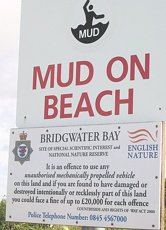 Bridgwater Bay - Mud danger signs on Bridgwater Bay near the mouth of the River Parrett are necessary because fast, high-amplitude tides here have led to drownings on the extensive mud flats.