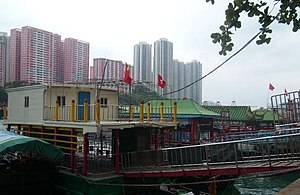 Aberdeen floating village - A family living on a boat.