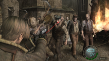 An image of a young man defending himself against a hoard of humanoid enemies in a village setting. The camera is behind the man's shoulder, placing him in the bottom left corner and the attackers in the background of the picture.