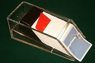 Shoe (cards) - A shoe holding four decks of cards with card cut (red)