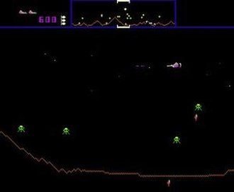 Defender (1981 video game) - The starship (upper right) flies along the planet surface to defeat enemies and protect astronauts. The status bar at the top depicts the remaining ships and special weapons, number of points earned, and a mini-map of the stage.