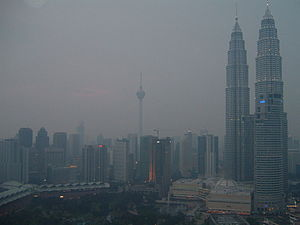 2006 in Malaysia - The business district of Kuala Lumpur in the evening of September 29, 2006 during 2006 Southeast Asian haze. Menara Kuala Lumpur was barely visible. The average API for that day was in between 70 and 80.