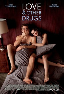 "Jamie (Jake Gyllenhaal) and Maggie (Anne Hathaway) are in torn blankets in bed, as information is below and ""Love and Other Drugs"" is at the top."