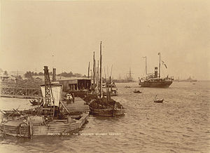 The paddle steamer Ramapoora (right) of the British India Steam Navigation Company on the Rangoon river having just arrived from Moulmein. 1895. Photographers: Watts and Skeen.