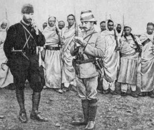 Italo-Turkish War - Mustafa Kemal (left) with an Ottoman military officer and Libyan mujahideen.