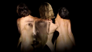 Tunnel Vision (Justin Timberlake song) - Screenshot from the music video, in which Timberlake's face is projected on the women's nude bodies