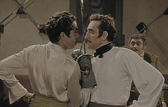 Tyrone Power - Power and Basil Rathbone in their duelling scene from The Mark of Zorro (1940) (Note: The movie was shot in black and white; this is the colorized version.)