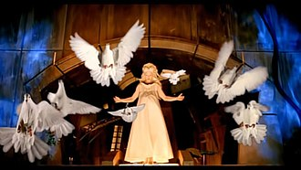 """Bedtime Story (Madonna song) - Madonna giving birth to a flock of doves in the """"Bedtime Story"""" music video; this scene was compared with Mexican surrealist artist Frida Kahlo's 1932 painting My Birth."""