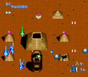 Blazing Lazers - The player dealing with enemy ships, shooting pyramids, and Moais in Area 5