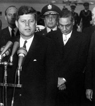 Braj Kumar Nehru - Ambassador Braj Nehru stands behind US president John F. Kennedy during Kennedy's speech welcoming Prime Minister Jawaharlal Nehru to the United States (1961)