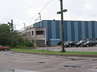 Burton Snowboards - Burton factory in 2009, including double chairlift, originally used at a resort, between streetlights