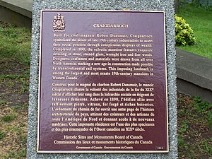Craigdarroch Castle - Historic Sites and Monuments Board of Canada Plaque in front of the castle.