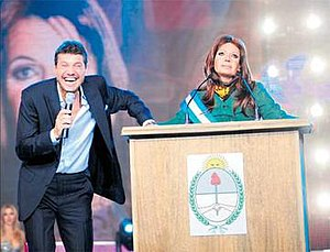 Public image of Cristina Fernández de Kirchner - Comedian Martín Bossi parodies the then Argentine president Cristina Fernández de Kirchner, next to TV host Marcelo Tinelli.