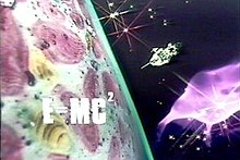The image depicts a futuristic spaceship moving past a brightly-coloured planet, with a nebula and stars in the background and the formula E=MC2 superimposed in bold white letters over the planet surface.