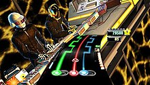 A video game screen. At the bottom, a curved arc shows three colored lines (green, red, and blue) that have round gems on them as well as move back and forth along the arc. A meter shows a scoring value and number of stars. Above and behind this, two human characters are using shown using a turntable mixer; the two characters are wearing black, futuristic objects and wear helmets to mask their identity.
