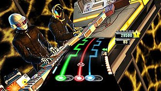 DJ Hero - DJ Hero presents the player with three tracks corresponding to the buttons on the turntable controller, along with features to insert beats or to adjust the crossfader. The game features avatars of several popular mix artists, including Daft Punk, shown here.