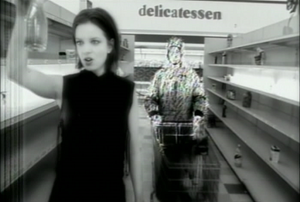 """Push It (Garbage song) - In a surreal moment of the """"Push It"""" video, Shirley Manson leads her partner to his assassination in a Los Angeles deli"""