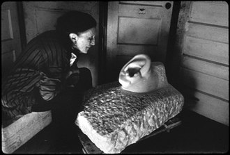 Inge Morath - Louise Bourgeois with her sculpture To Fall on Deaf Ears, 1991.