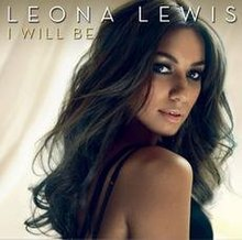 "Picture of a woman who is looking back as she sightly smiles. She wears a black dress and she has long hair of the same colour. Above her head, the words ""Leona Lewis"" and ""I Will Be"" are written in white and golden capital letters, respectively."