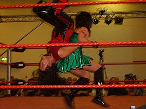 Piledriver (professional wrestling) - Cheerleader Melissa performing her Kudo Driver (Back-to-back double underhook piledriver) finisher on Wesna.
