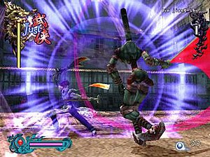 Bujingai - The player character battles an enemy. Health and defense meters for the player and enemy are displayed top left and top right respectively. The player's magic meter is on the bottom left and collected blue orbs on bottom right.
