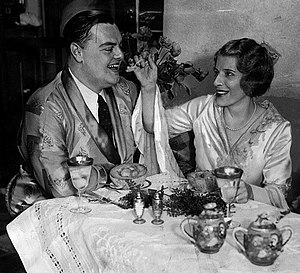 Aimee Semple McPherson - Aimee Semple McPherson and her third husband, David L. Hutton, enjoying their honeymoon breakfast.  To avoid news publicity, they chartered a plane to Yuma, Arizona; and were married in a small ceremony. Hutton assisted in some of McPherson's charity work before their divorce in 1934.
