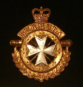 Maltese cross - The badge of the British Army's Bermuda Regiment combines the eight-pointed cross of rifle regiments with elements from that of the Royal Artillery