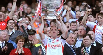 Brian Dooher - Dooher accepts the Sam Maguire Cup for the second timein 2008
