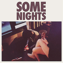 The album's title is written in brown letters while below it is a rectangular picture of two people in a motel with the man sitting down with a lighter and the woman with her legs crossed holding a cigarette.
