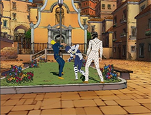 "A screenshot showing two young men in a town environment, facing off in a battle. The one on the right, Bucciarati, has summoned a spirit-like, humanoid ""Stand"", which he uses to attack the man on the left, Giorno."