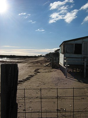 Middle Beach, South Australia - Looking north along the beachfront shacks
