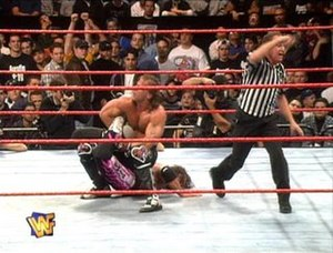 "Montreal Screwjob - The ""Screwjob""—Earl Hebner, under orders from Vince McMahon, calls for the bell as Shawn Michaels holds Bret Hart in the Sharpshooter finishing move, although Hart did not submit."