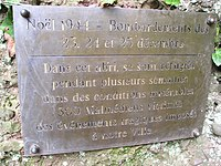 Plaque next to cave where civilians have been hiding during the bombings of 23,24,25 december 1944