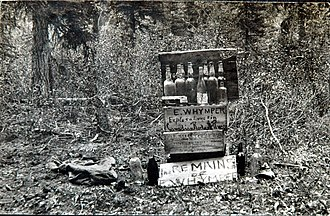 "Christian Kaufmann (alpine guide) - Humorous mischief: Whymper's liquor bottles with a sarcastic sign that reads, ""The Remains of E. Whymper"" (1901)."