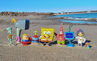 Photograph of a SpongeBob SquarePants figure set on a beach