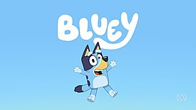 """An animated image of an anthropomorphic Blue Heeler puppy, jumping in the air with her arms thrown out beside her, smiling. The dog is coloured blue and displayed in front of a blue background. The word """"Bluey"""" is above her head in white lettering."""