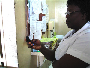 MHealth - Nurse using a mobile phone in Accra, Ghana
