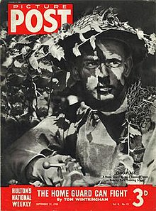 Cover of the Picture Post dated 21 September 1940. Caption: Camouflage - a home guard learns a lesson in cover at Osterley Park Training School