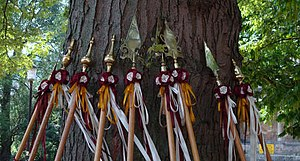 Stave dancing - Somerset Morris' staves. The team use original 19th century friendly society brasses for their stave heads.