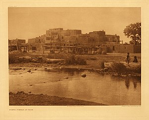 Rio Pueblo de Taos - Photograph of the North Pueblo at Taos, across Rio Pueblo de Taos, by Edward S. Curtis, circa 1925