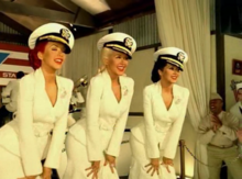A scene of the music video where three versions of Aguilera are visible